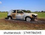 burnt out car in field. stolen... | Shutterstock . vector #1749786545