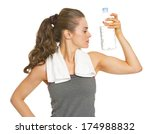 fitness young woman with bottle ... | Shutterstock . vector #174988832