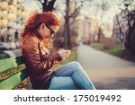 young woman using a smart phone ... | Shutterstock . vector #175019492