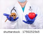 The Doctor Holds A Red Heart In ...