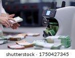 Bank Employees Using Money...