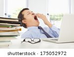 exhausted young businessman... | Shutterstock . vector #175052972
