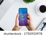 Small photo of Fast Money Transfers. Woman Holding Smartphone With Transaction Completed Message On Screen, Sitting At Desk In Office, Top View