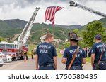 Small photo of Ogden, Utah / United States - June 6th 2020: The Ogden City Fire Department erects a giant American Flag to honor fallen Ogden Officer Nate Lyday, who lost his life in the line of duty May 28th, 2020