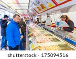 ZWOLLE, THE NETHERLANDS - FEBRUARY 1, 2014: Unidentified people buying groceries at the street market in Zwolle. In the Netherlands there are 18,000 merchants realizing a 2.6 billion turn over. - stock photo