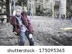 sad lonely boy sitting on swing   Shutterstock . vector #175095365