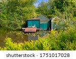 A Boathouse On A Small River