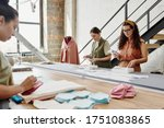 group of three young designers... | Shutterstock . vector #1751083865