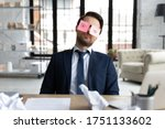Exhausted Male Employee Sit At...