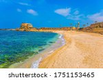 The port of King Herod in ancient Caesarea and the restored embankment. Excursion to the Archaeological Park of the Roman Empire. Израиль. Concept of ecological and historical tourism