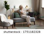 Happy 50s Senior Woman Sit...