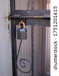 A Large Metal Padlock With A...