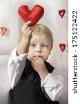 little boy with red heart in... | Shutterstock . vector #175122422