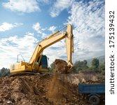 Excavator Loading Dumper Truck...
