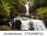 Idyllic Waterfall In Forest...