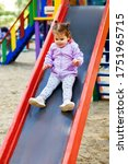 A Little Girl Descends From A...