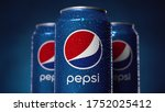 Small photo of Moscow, Russia - 08 06 2020: Cinematic three Pepsi metal can spins or rotate on blue background. Pepsi sign in frame. Wet tin in small drops of water. Classic red blue and white logo pepsico close up.