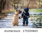 Stock photo boy with cute dog giving him a kiss 175204865