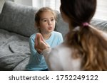 Small photo of Small preschooler disabled girl practice nonverbal talk with female nanny or tutor at home, cute little child make hand gesture learn speak sign language with mother, children disability concept