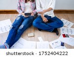 Young Couples With Debt...