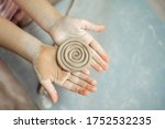 Kid\'s Hands Hold Clay Product....