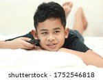 Cute Little Asian Boy Child...