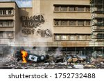 Small photo of Black Lives Matter protest riot vandalism, looting aftermath concept, flaming police car smashed, overturned with black lives matter text slogan message on building. Excessive force, police brutality