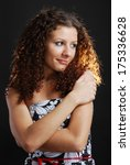 frizzy woman crossed arms on...   Shutterstock . vector #175336628