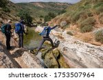 Hikers On A Hiking Trail Along...