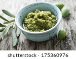 bowl with fresh olive paste... | Shutterstock . vector #175360976