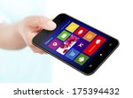 hand holding mobile phone with... | Shutterstock . vector #175394432