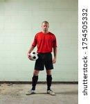 Soccer Player Holding Ball...