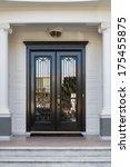Closed Ornate Wood Door Of An...