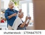 Woman Cutting Her Elderly...