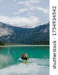 Young Couple Kayaking On...