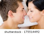 headshot of couple lying in bed ... | Shutterstock . vector #175514492