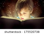child opened a magic book | Shutterstock . vector #175520738