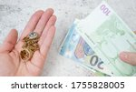Small photo of jewelry scrap of gold and silver and money, pawnshop concept jeweler looking at jewelry through magnifying glass, jewerly inspect and verify