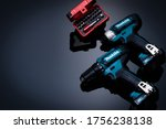 Small photo of CHONBURI, THAILAND-MAY 24, 2020 : Makita cordless driver drill with screw bit set in case on dark background. Makita tools. Single sleeve keyless driver drill chuck for easy bit installation/ removal.