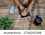 hands praying with a bible in a ... | Shutterstock . vector #1756242398