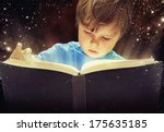 child opened a magic book | Shutterstock . vector #175635185