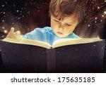 child opened a magic book | Shutterstock . vector #175635185