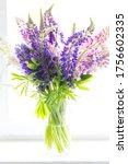 wild lupines bouquet in day... | Shutterstock . vector #1756602335