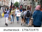Small photo of London, United Kingdom. 15th June 2020 Customers carry shopping bags on the street of Oxford as Non-essential shops are allowed to reopen from today provided they abide by the governments' Covid rules