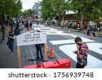 """Small photo of Seattle, Washington / USA - June 10 2020: """"You Are Now Entering Free Cap Hill"""" beside a """"Blacks Lives Matter"""" mural at the Capitol Hill Occupied Protest (CHOP)"""