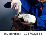 Small photo of Close up of hand Technician man using to loosen nut in the industrial factory, Industrial Concept