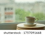 Coffee Cup On A Rainy Day...