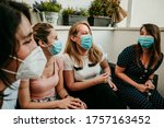 Small photo of Happy group of girlfriends meeting after the quarantine caused by the covid pandemic19. Taking caution with the use of surgical masks. New normal.