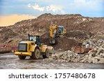 Front End Loader And Excavator...