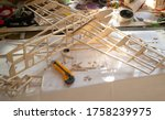 Small photo of Making model airplane from balsa wood. handcrafted on work table